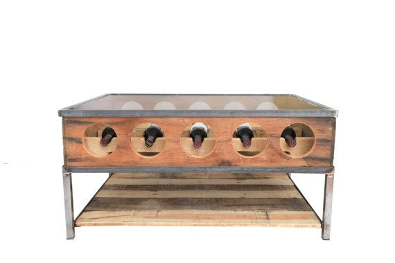 Who doesn't want a handmade wine coffee table?!  I mean seriously!  Wine rack coffee Table by MichaelGrahamDesigns on Etsy, $699.00