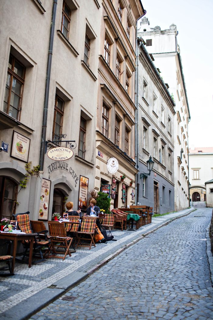 Outdoor cafes; people watching; cobblestone; exploring!  Cobblestone Lane Prague | photography by http://www.entouriste.com/