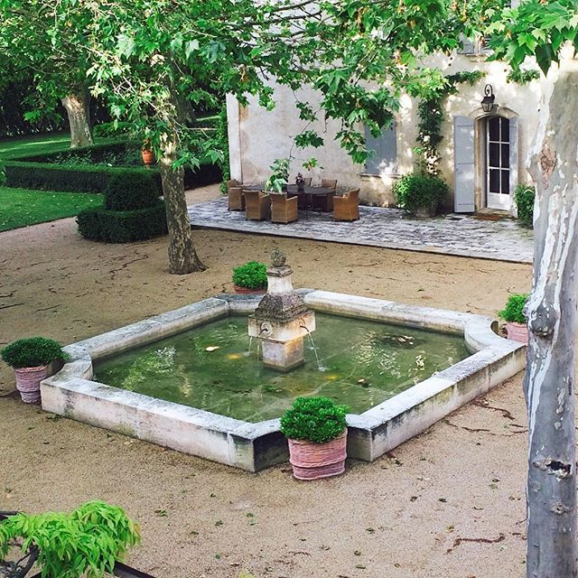 MAS MON BLAN, Provence. Early morning view from my bedroom window.  #frenchgarden #gardensofinstagram #courtyardgarden #masmontblan #mykindofholiday #provence #travel #france #waterfeature #gravel #planetrees