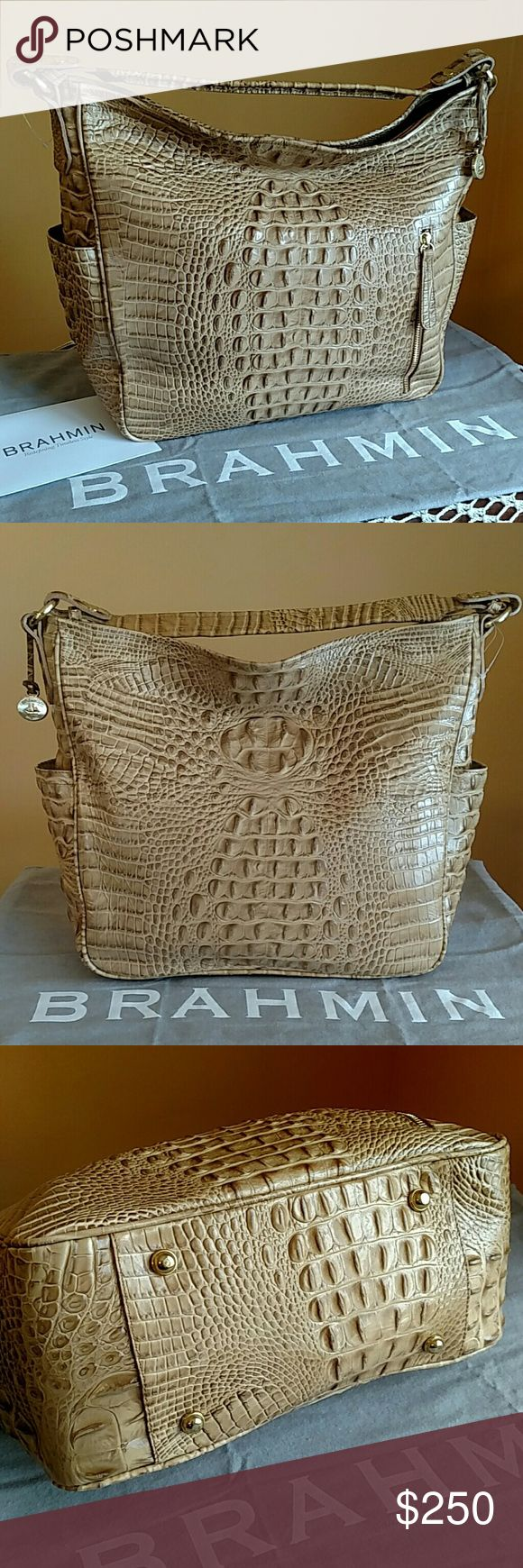 Brahmin Candace  - Praline Melbourne Stylish neutral-colored Brahmin large hobo in croc-embossed leather; goes with everything and fits all of your everyday essentials!  Never used and in great condition--still has the protective plastic on the medallion and interior logo plate, and plastic price tag hanger.  Roomy interior with two slip pockets, two zippered pockets, key clip, and two pen loops.  Exterior has brass hardware, protective feet, two side pockets, and front zip pocket.  Comes…