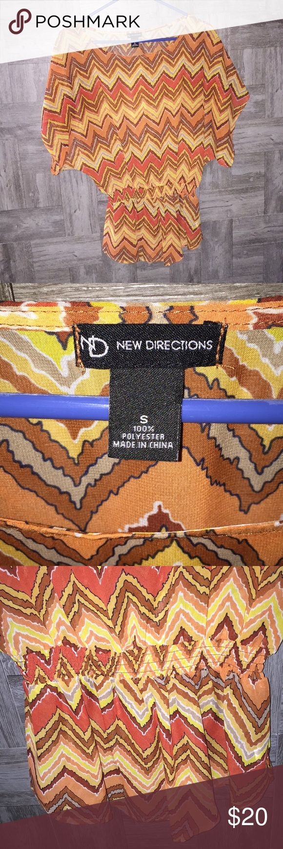 New Directions Chevron Top This is definitely fall colors.  Chevron top of burnt orange, yellow, browns, white and black.  Has the elastic around waist and is sheer as well.  Dress it up for a night on the town or dress it down with jeans or leggings.  Great shape!  Super cute! new directions Tops Blouses