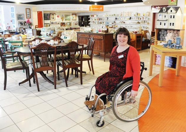 Katie Smedmor volunteers at the Sue Ryder shop in Downham Market. Picture: Ian Burt