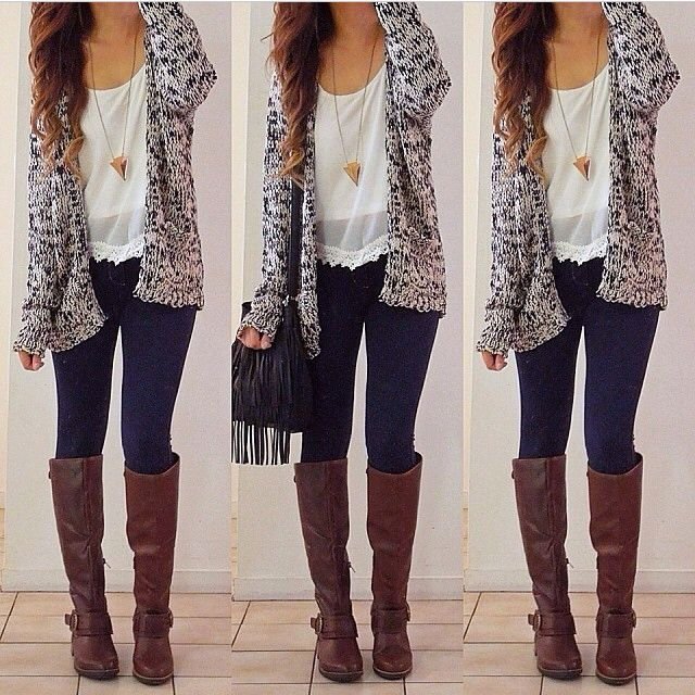 Nice black and gray sweater, dark skinny jeans, and tall brown leather boots.