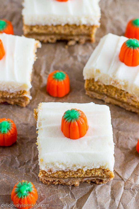 Easy Pumpkin Cheesecake Bars topped with cream cheese frosting-perfect holiday dessert recipe.
