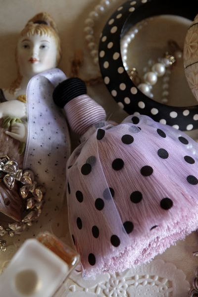 Polka dot in pink and black.