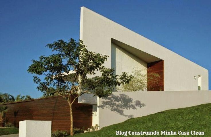 Fachadas de casas em terrenos em declive como construir - Construir casa moderna ...