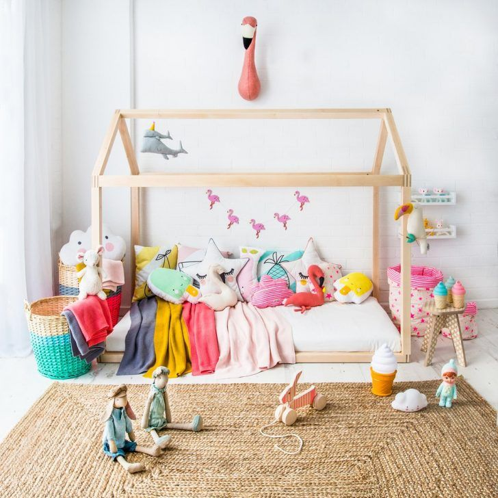 If you are looking for a more open design, check out House Bed at Bobby Rabbit. This bed frame is the perfect canvas for you to go wild decorating with fun accessories and for your little one to play house all day. Also placed at ground level, the bed is as accessible as they get. We love how cosy this one looks with all the blankets, different shaped cushions and a combination of simple elegant neutral colours with bright and exciting extras.