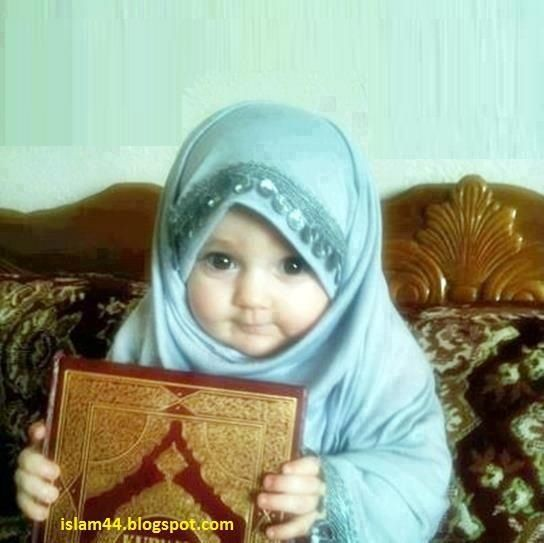 A very cute Muslim child wearing a scarf     SO