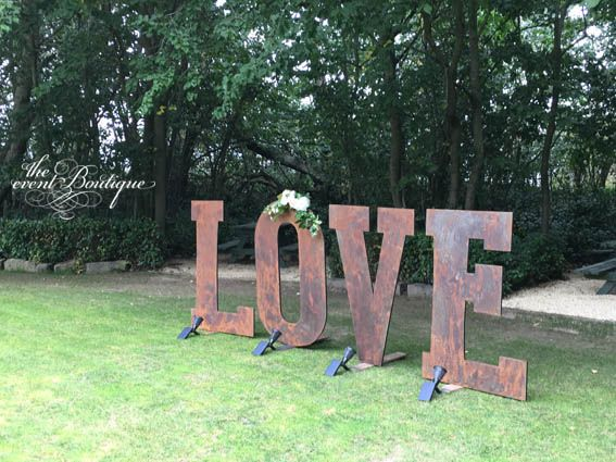 Our custom-made giant LOVE sign in rustic finish, with fresh floral garland. Solar spotlights turn this into a dramatic feature as dusk arrives.