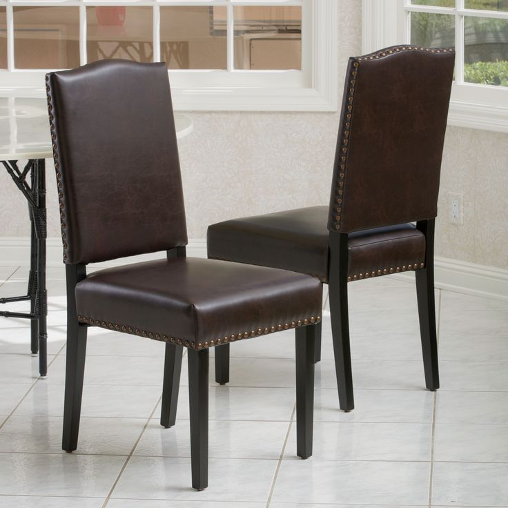 The Brunello dining chairs offer users comfortable seating in an elegant style. Upholstered in brown bonded leather and detailed with bronze studs, you'll be sure to impress guests with these dining chairs.