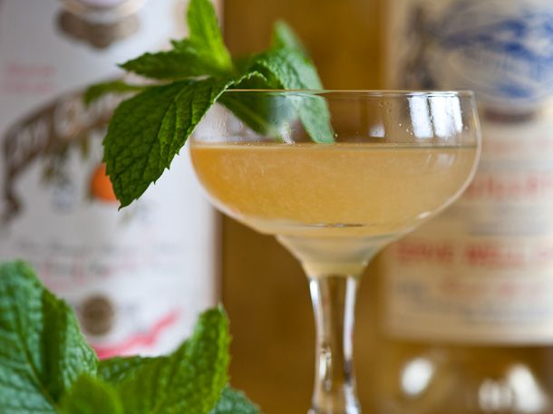 Kentucky Corpse Reviver | 3/4 ounce Elijah Craig Bourbon, 3/4 ounce Pierre Ferrand Curaçao, 3/4 ounce fresh juice from 1 lemon, 3/4 ounce Lillet Blanc, Garnish: mint sprig