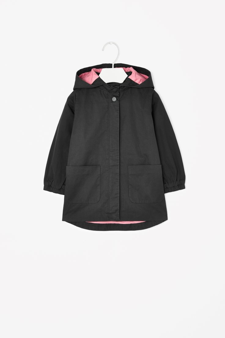 A flared A-line shape, this parka is made from soft cotton twill with a bright contrast colour interior. Designed for comfortable everyday wear, it has a detachable hood, elasticated cuffs and flat front pockets. It is secured with a hidden front zip and press stud fastening.