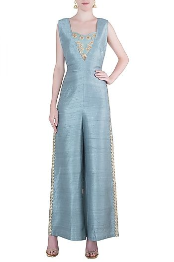 b4d5c21b1c2 Natasha J Featuring a mineral blue parallel jumpsuit in raw silk base with  deep cut. It is paired with a matching bustier in cotton lycra base with  thread ...