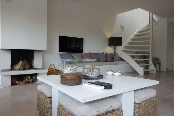Fireplace from the couch, flat screen, high spec Samsung television, stairways to first floor