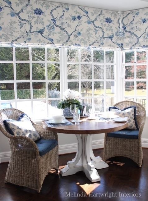 white marble kitchen, blue and white fabric roman blinds, rattan armchairs, herringbone timber floor, bay window - kitchen
