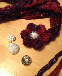 Sashay yarn flower | With remaining yarn and a size K hook, make a simple flower and sew it ...