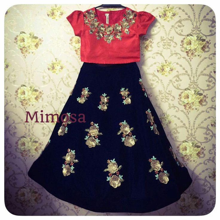 Black skirt with golden patch work goes classy with a red crop top