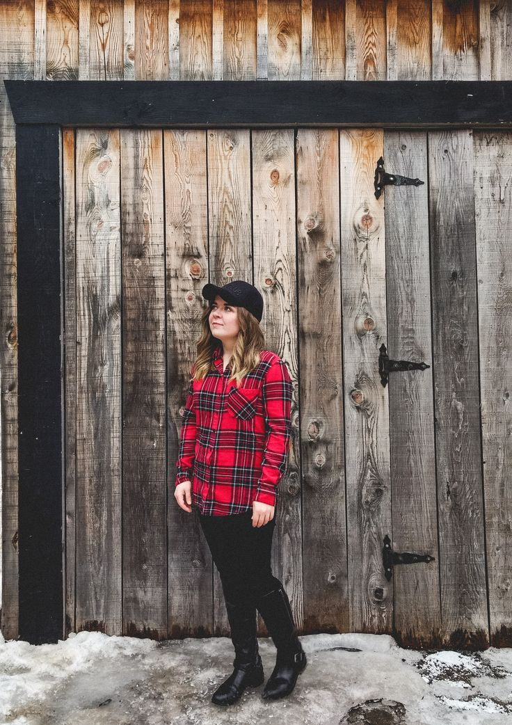Red plaid flannel shirt with black denim and boots.