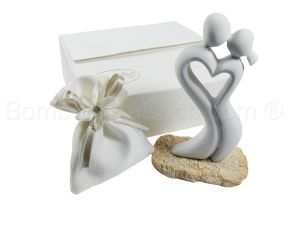 Stylized sculpture of lovers with a favour bag filled with a choice of dragees, candy, sugared almonds. Truely beautiful stunning Italian #bomboniere #wedding #favour #favor http://www.bombonierashop.com/en/department/4/Wedding-Favours.html