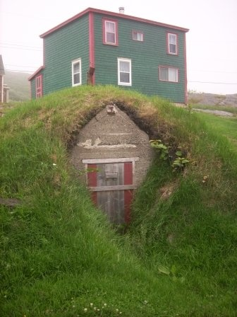 Newfoundland Saltbox home with a root cellar. It was used for storing the vegetable harvest and preserves throughout the long winter.