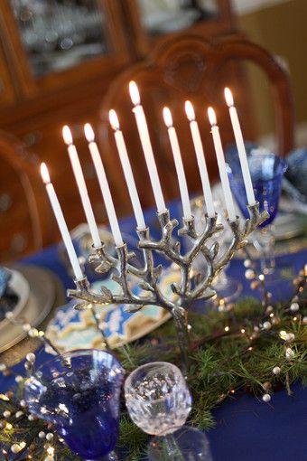 A Tree of Life Menorah is the centerpiece of a Hanukkah table designed by JoAnn Berkoff.