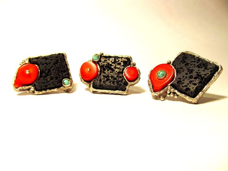 Fine and sterling silver cuff-links set with lava, coral and turquoise. Various fabrication techniques, including lapidary. I often make sets of three (instead of two) not-quite-matching pieces, to involve the wearer in the creative process, as they need to decide on a combination of their choice. Artist: Alan Samons – South Africa. Cuff-links 2013