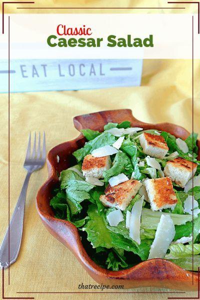 Classic Caesar Salad is a simple but delicious salad made with romaine lettuce, Parmesan cheese and croutons with a savory dressing. #caesarsalad #saladdressing