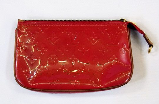 Louis Vuitton red 'Monogram Vernis' clutch bag, with zip. Estimate £100.00 to £150.00 (Lot no: 159 in sale on 05/08/2014) The Cotswold Auction Company