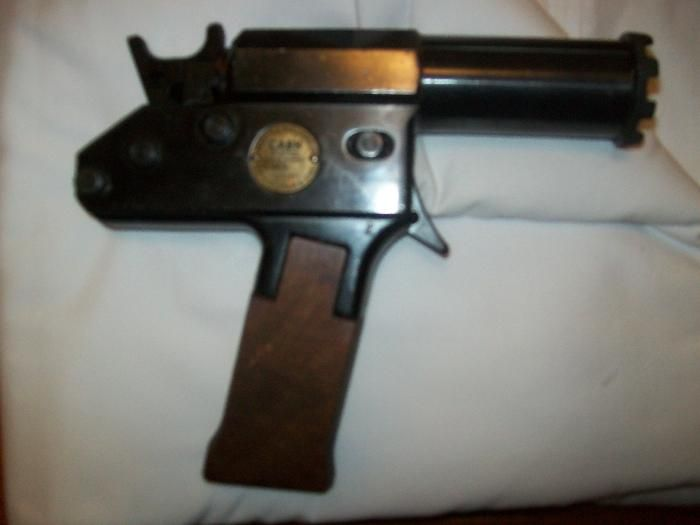 captive bolt pistol - Don't know what year but in my world it's from 1922. :P