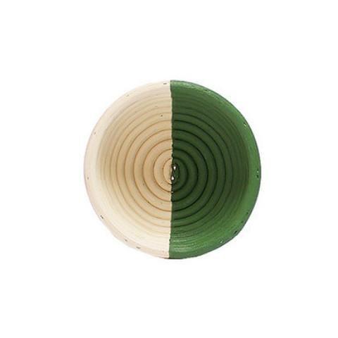 birdseye view of small circular rattan basket half painted green