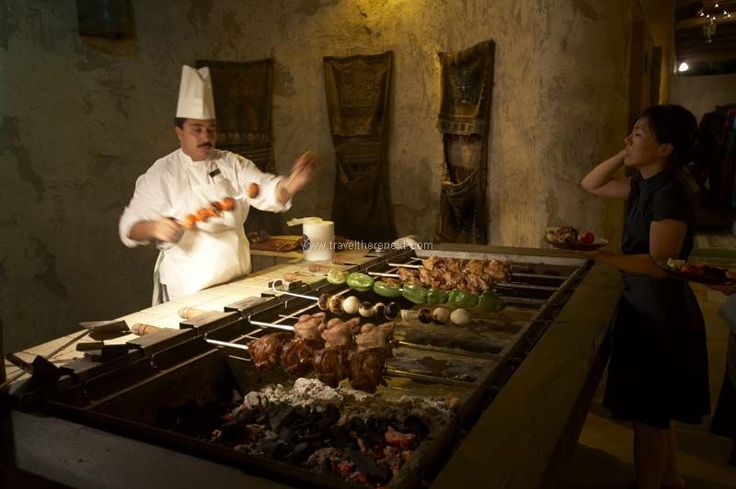 Jumeirah restaurants - Chef cooking for diners at Al Hambra  #uae #middleeast #dubai #resort #accommodation #hotel #relax #experience #luxury #travel #traveltherenext #madinetjumeirah #dining #restaurant #food