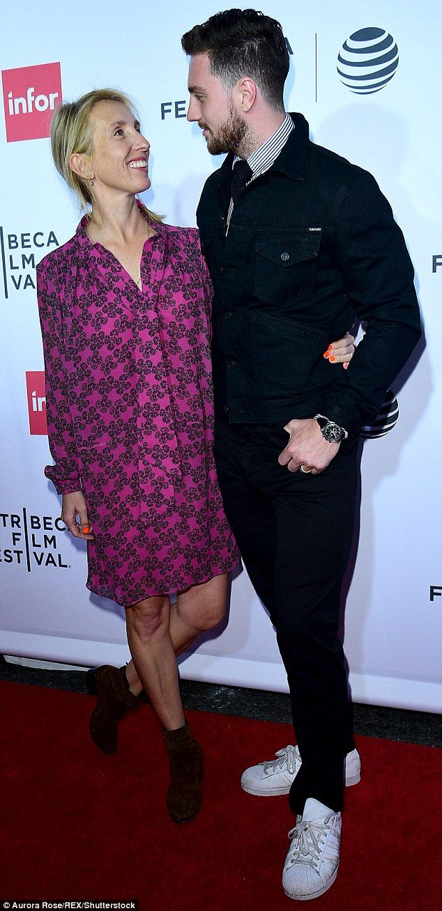 The look of love: Aaron Taylor-Johnson, 25, and Sam Taylor-Wood, 49, still appeared to be ...