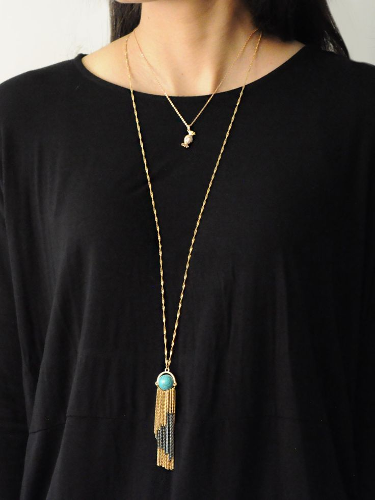 Brighton Tassel Necklace -  INR 1,599 -  This bohemian necklace features a multi metallic tassel pendant on a golden chain. The pendant has a Turquoise sphere and looks great with almost anything. You can layer this necklace with others or wear on its own.