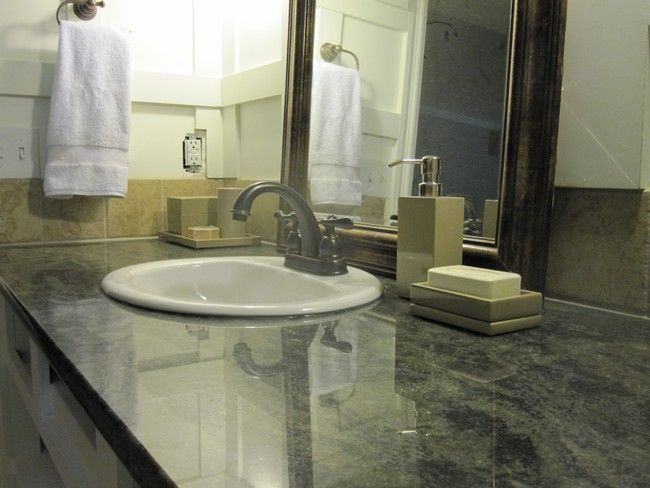 Low-maintenance marble countertop with white, undermount sink