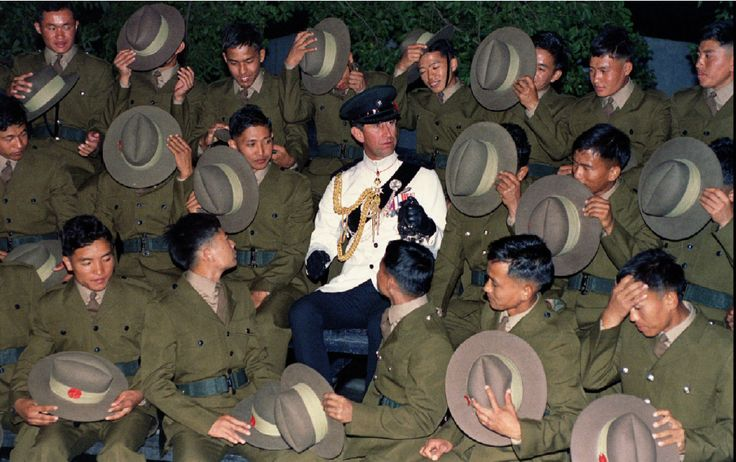 Last recruit Gurkha soldiers surrounding Prince Charles take off their hats during a gathering at Hong Kong's Sek Kong airforce base on November 8, 1994, as part of the last passing-out parade in the British colony.(Reuters)