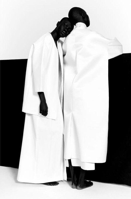 Minimal White Coat - bold minimalist style, black & white fashion editorial // Ph. Paul Jung