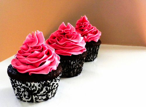 Dark chocolate cupcakes with high bright frosting
