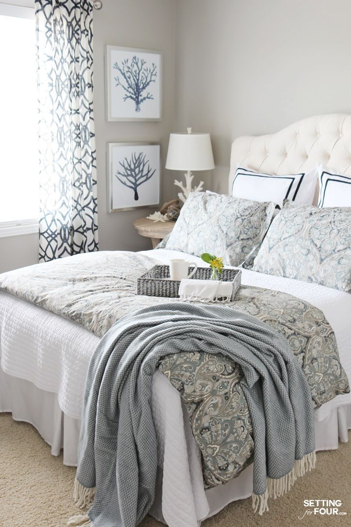 beautiful white bed cover guest bedroom ideas have white lamp shade on round nightstand white painted wall