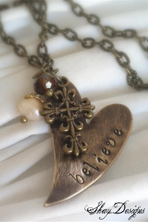 Hand stamped bronze heart pendant.