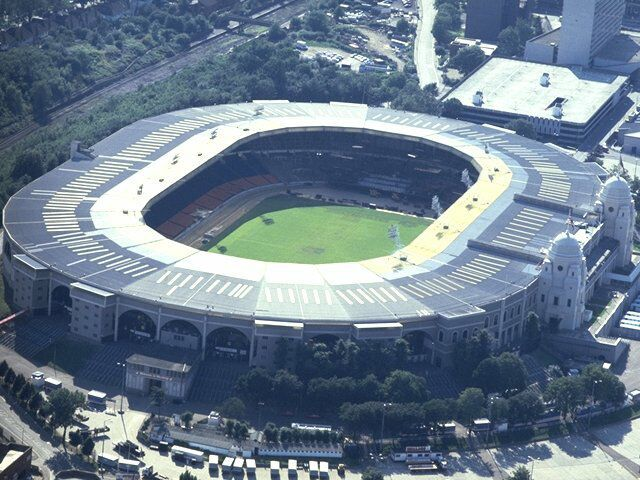 Wembley Stadium,London,England. I visited this place in 1983 & 1984.  For Both an N.F.L Game between the Minnesota Vikings and the St.Louis,Cardnials. And a U.S.F.L. Game between the Tampa Bay Bandits & The Philadelphia Stars.
