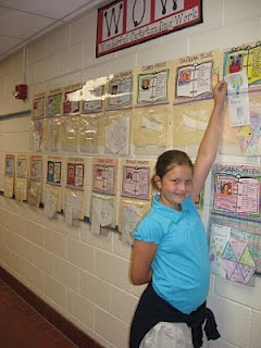 "SO SMART! The displays are made with file folders in the first few days of school. Students complete an ""about me"" sheet that is attached to the first part of the file folder. The entire file folder is then laminated. A gallon sized storage bag is added to the bottom part of the file folder for students' work to be displayed."