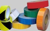 Reflective hazard tape for marking floors or aisles