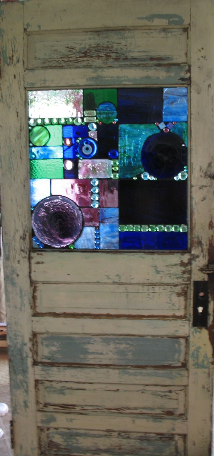 glass mosaic on old door. Very Cool! I wanna make this one day!