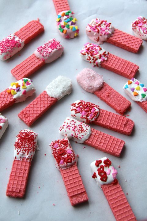 Make this dessert in a cinch with pink wafer cookies, a variety of Valentine's Day sprinkles, and white melting chocolate.   #easyrecipe #valentinesday #food #ideas #pastryporn #forkyeah #recipes #comfortfood #inspiration #kids