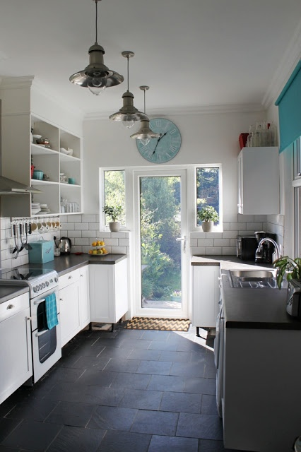 White kitchen subway tiles pendant lights with turquoise accents  Swoon Worthy - counter color