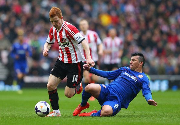 Jack Colback of Sunderland is tackled by Gary Medel of Cardiff City   during the Barclays Premier League match between Sunderland and Cardif...