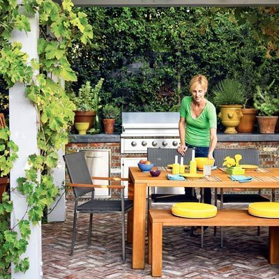 For built-in outdoor kitchens with plumbing and electric, you'll likely need some help from the pros. Follow this game plan: 1. Hire a contractor (if needed). 2. Get permits. 3. Gather materials. 4. Run utility lines. 5. Install hardscaping. 6. Buy appliances. 7. Add built-ins. 8. Hook up lighting