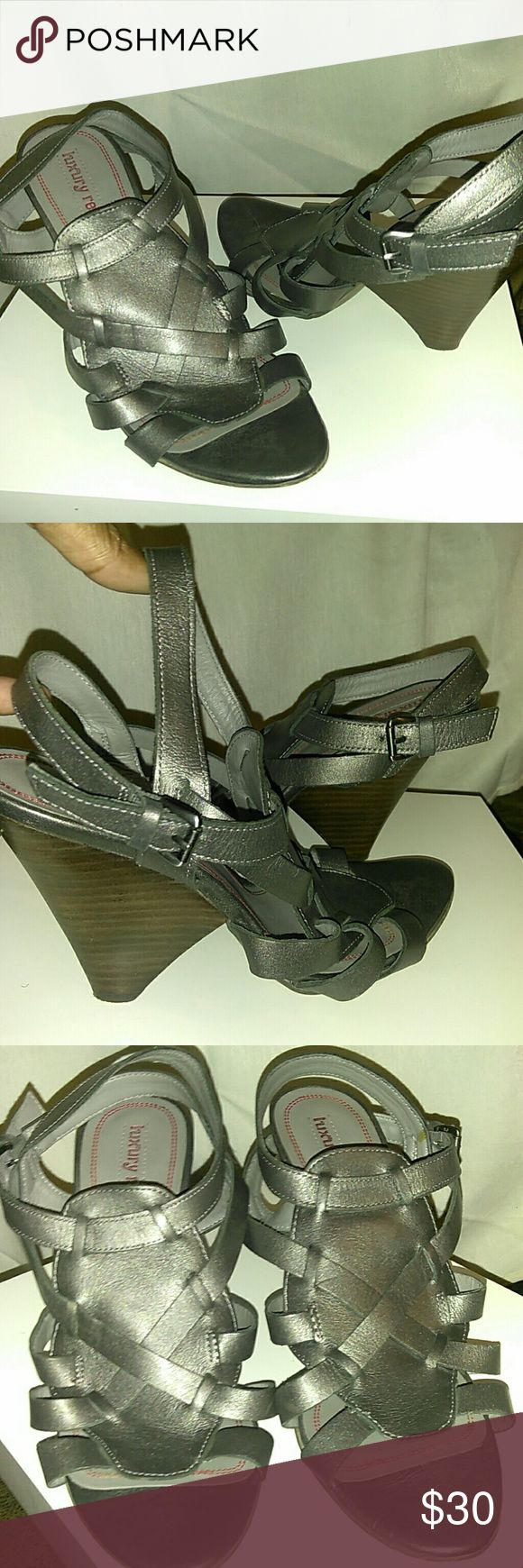 Women's shoes Luxury brand silver shoes.. Double strap around the ankle beautiful criss cross details in the front. It says 39 but fits like an 7 1/2 or 8EUC luxury rebel Shoes Sandals