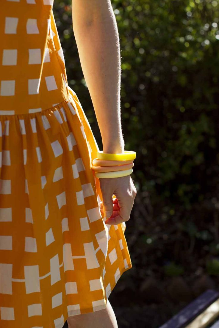 Milk from a Thistle dress with Dinosaur Designs bangles
