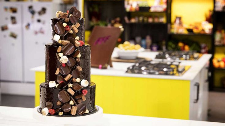 Inspired+by+the+cakes+her+mother+made+for+her+as+a+child,+Anna+Polyviou+created+this+monster+chocolate+glazed,+lolly+filled+tower+for+her+ultimate+Family+Food+Fight+challenge.+It+might+be+a+overwhelming+at+100++steps,+but+it's+worth+every+moment+to+create+this+childhood+dream,+complete+with+the+taste+of+Milo,+Fantales,+raspberries+and+caramel+popcorn.+It+nearly+brought+some+of+the+Family+Food+Fight+contestants+undone,+but+everyone+rose+to+the+challenge,